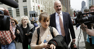 Actress Allison Mack leaves Brooklyn federal court.