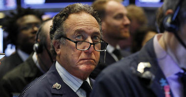 Trader Steven Kaplan works on the floor of the New York Stock Exchange.