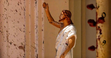 Blood stains are seen on the wall and on a Jesus Christ statue at the St. Sebastian's Church after blast in Negombo, north of Colombo, Sri Lanka, Sunday, April 21, 2019.