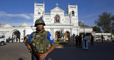 Sri Lankan air force officers and clergy stand outside St. Anthony's Shrine.