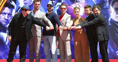 """Marvel Studios Pres. Kevin Feige, from left, poses with members of the """"Avengers: End Game,"""" cast Chris Hemsworth, Chris Evans, Robert Downey Jr., Scarlett Johansson, Jeremy Renner and Mark Ruffalo at a hand and footprint ceremony at TCL Chinese Theatre."""