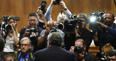Attorney General William Barr is photographed as he sits down to testify before the Senate Judiciary Committee on Capitol Hill in Washington, Wednesday, May 1, 2019.