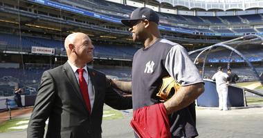 Former Liverpool goalkeeper Bruce Grobbelaar and New York Yankees pitcher CC Sabathia