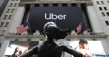 The statue of Fearless Girl stands in front of the New York Stock Exchange before Uber, the world's largest ride-hailing service, holds its initial public offering, Friday, May 10, 2019.
