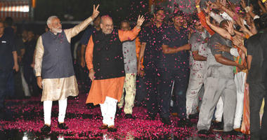 Modi's Hindu nationalist party claimed it won reelection with a commanding lead in Thursday's vote count, while the head of the main opposition party conceded a personal defeat that signaled the end of an era for modern India's main political dynasty.