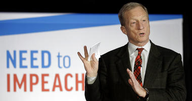 "Tom Steyer speaks during a ""Need to Impeach"" town hall event."