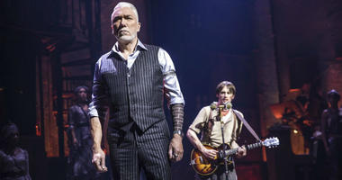 """This image released by DKC O&M Co. shows Patrick Page, left, and Reeve Carney during a performance of """"Hadestown,"""" directed by Rachel Chavkin."""