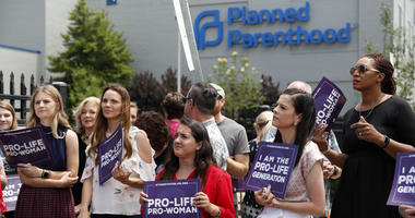 In this June 4, 2019, file photo, anti-abortion advocates gather outside the Planned Parenthood clinic in St. Louis.