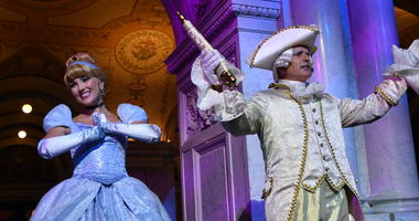 """Costumed Cinderella and Majordomo appear before guests at an event marking the inclusion of Disney's """"Cinderella"""" into the National Film Registry on its 70th anniversary, Thursday night, June 20, 2019 at the Library of Congress in Washington."""
