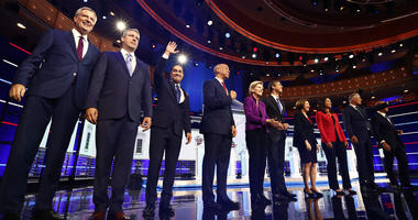 From left, Bill de Blasio, Tim Ryan, Julian Castro, Cory Booker, Elizabeth Warren, Beto O'Rourke, Amy Klobuchar, Tulsi Gabbard, Jay Inslee, John Delaney are shown on stage before the start of a Democratic primary debate, Wednesday, June 26, 2019.