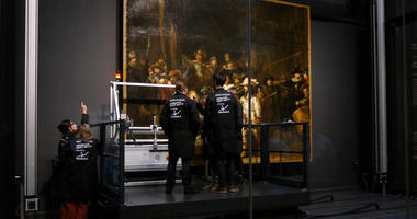 Technicians and researchers check equipment set up inside a glass chamber as they begin to study Rembrandt's 'Night Watch' masterpiece, at the Rijksmuseum in Amsterdam, Monday July 8, 2019.