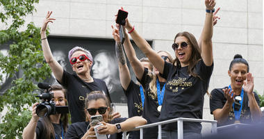 Members of the U.S. women's soccer team, including Megan Rapinoe, rear left, and Alex Morgan, right foreground, stand on a float before being honored with a ticker tape parade along the Canyon of Heroes in New York, Wednesday, July 10, 2019.