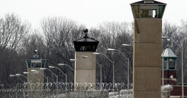 In this March 17, 2003 file photo, guard towers and razor wire ring the compound at the U.S. Penitentiary in Terre Haute, Ind., the site of the last federal execution.