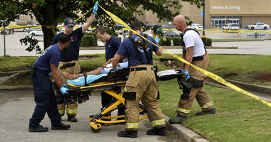 Paramedics offer medical attention after a shooting at a Walmart store Tuesday, July 30, 2019 in Southaven, Miss.