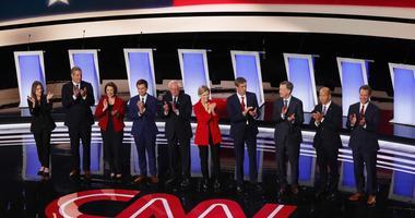From left: Marianne Williamson, Tim Ryan, Amy Klobuchar, Pete Buttigieg, Bernie Sanders, Elizabeth Warren, Beto O'Rourke, John Hickenlooper, John Delaney and Steve Bullock take the stage for a Democratic primary debate in Detroit.