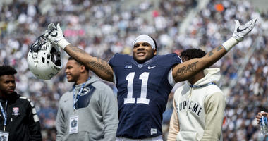 In this April 21, 2018, file photo, Penn State linebacker Micah Parsons acknowledges the crowd before the Blue-White spring college football game in State College, Pa.