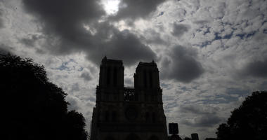 Notre Dame cathedral is silhouetted as environmental groups and unionists attend a news conference to warn against lead particles polluting the air in the area, and ask for a regularly updated chart showing pollution levels in Paris, France.