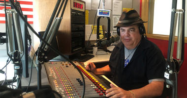 In this Friday, Aug. 2, 2019, photo, Scott Bremner, talk radio host, works in Erie, Pa.