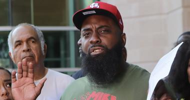 Michael Brown Sr. speaks to the media on Friday, Aug. 9, 2019, the fifth anniversary of the death of his son, Michael Brown, in front of the justice center in Clayton, Mo.