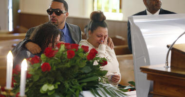 Friends and family mourn Derrick Fudge on Saturday, Aug. 10, 2019, at a church in Springfield, Ohio. Fudge, 57, was the oldest of nine who were killed when a gunman opened fire outside a bar early Sunday in Dayton, Ohio.