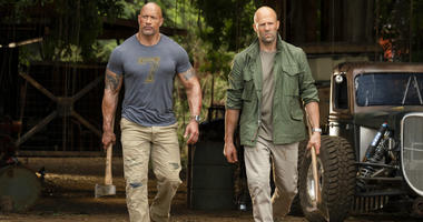 "This image released by Universal Pictures shows Dwayne Johnson, left, and Jason Statham in a scene from ""Fast & Furious Presents: Hobbs & Shaw."""