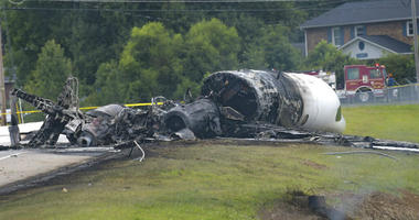 The burned remains of a plane that was carrying NASCAR television analyst and former driver Dale Earnhardt Jr. lie near a runway Thursday, Aug. 15, 2019, in Elizabethton, Tenn.