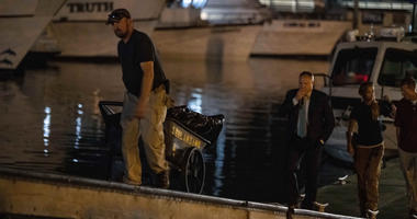 Authorities take evidence from boat fire scene