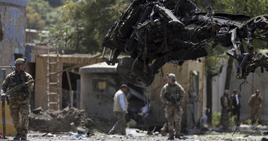 Resolute Support (RS) forces remove a damaged vehicle after a car bomb explosion in Kabul, Afghanistan, Thursday, Sept. 5, 2019.