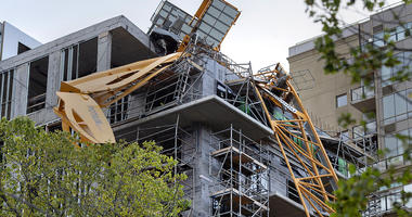 toppled building crane