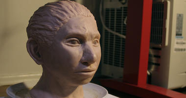 This image shows a statue reconstruction of a juvenile female Denisovan based on a skeletal profile reconstructed from ancient DNA methylation maps.