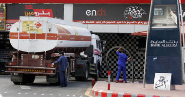 Workers refuel the tank at a gas station in Jiddah, Saudi Arabia, Tuesday, Sept. 17, 2019.
