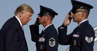 President Donald Trump boards Air Force One at Marine Corps Air Station Miramar, Wednesday, Sept. 18, 2019, in San Diego, Calif.