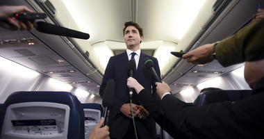"Canadian Prime Minister and Liberal Party leader Justin Trudeau makes a statement in regards to a photo coming to light of himself from 2001, wearing ""brownface,"" during a scrum on his campaign plane in Halifax, Nova Scotia, Wednesday, Sept. 18, 2019."