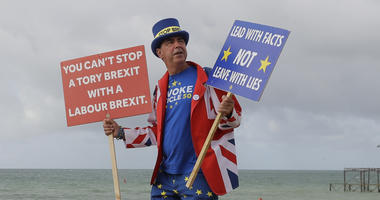 Anti Brexit campaigner Steve Bray walks on the beach to pose for a photograph during the Labour Party Conference at the Brighton Centre in Brighton, England, Monday, Sept. 23, 2019.
