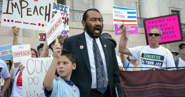 Rep. Al Green, D-Texas, joins impeachment activists with a youth-led group, By The People, to call for Congress to remove President Donald Trump from office, outside the Rayburn House Office Building on Capitol Hill in Washington, Monday, Sept. 23, 2019.