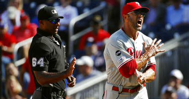 Philadelphia Phillies manager Gabe Kapler, right, reacts after Brad Miller was ejected by umpire Alan Porter.