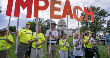 Activists rally for the impeachment of Trump