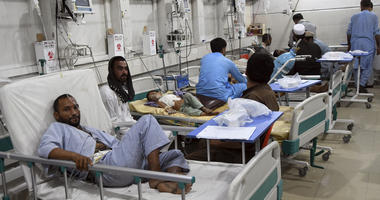 Wounded Afghans lie on a bed at a hospital after a bomb attacks in the city of Jalalabad east of Kabul, Afghanistan, Saturday, Sept. 28, 2019.