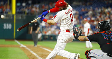 Philadelphia Phillies' Bryce Harper (3) hits a three-run home run off Miami Marlins relief pitcher Wei-Yin Chen during the sixth inning of a baseball game.