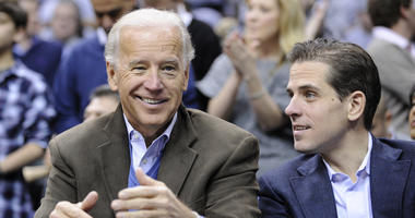 File photo: Vice President Joe Biden, left, with his son Hunter, right, at the Duke Georgetown NCAA college basketball game in Washington.