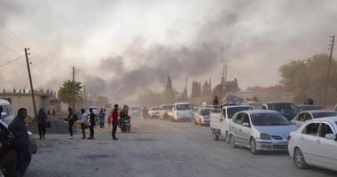 Syrians flee shelling by Turkish forces in Ras al Ayn, northeast Syria.