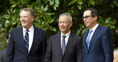 Chinese Vice Premier Liu He accompanied by U.S. Trade Representative Robert Lighthizer, left, and Treasury Secretary Steven Mnuchin, greets the media before a minister-level trade meetings at the Office of the United States Trade Representative in Washing
