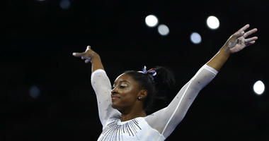 Simone Biles of the United States performs on the vault in the women's all-around final at the Gymnastics World Championships in Stuttgart, Germany.