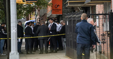 NYPD investigates the scene of a shooting in the Brooklyn borough of New York on Saturday, Oct. 12, 2019.