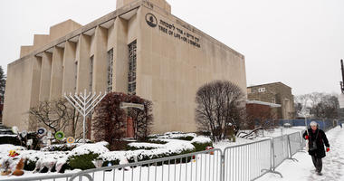 A woman passes by the Tree of Life Synagogue in Pittsburgh's Squirrel Hill neighborhood.