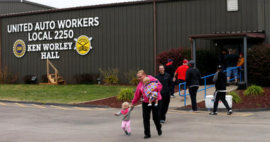 United Auto Worker Lindsey Higgins, exits the the UAW Local 2250 Ken Worley Hall with her two children after voting on the offer made to union workers by General Motors on Thursday, Oct. 24, 2019.