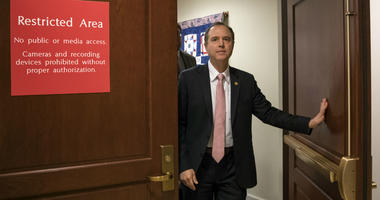 In this March 22, 2018 file photo, Rep. Adam Schiff, D-Calif., ranking member of the House Intelligence Committee, exits a secure area to speak to reporters, on Capitol Hill in Washington.