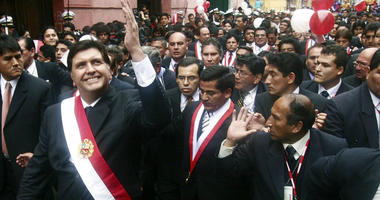 In this July 28, 2006 file photo, Peruvian President Alan García waves to a crowd after his swearing-in ceremony while he walks through the streets of Lima, Peru.