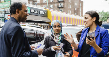 Alexandria Ocasio-Cortez, right, during a Bengali community outreach in New York.