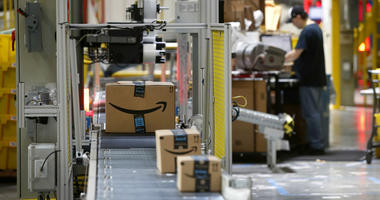In this Aug. 3, 2017, file photo, packages pass through a scanner at an Amazon fulfillment center in Baltimore.